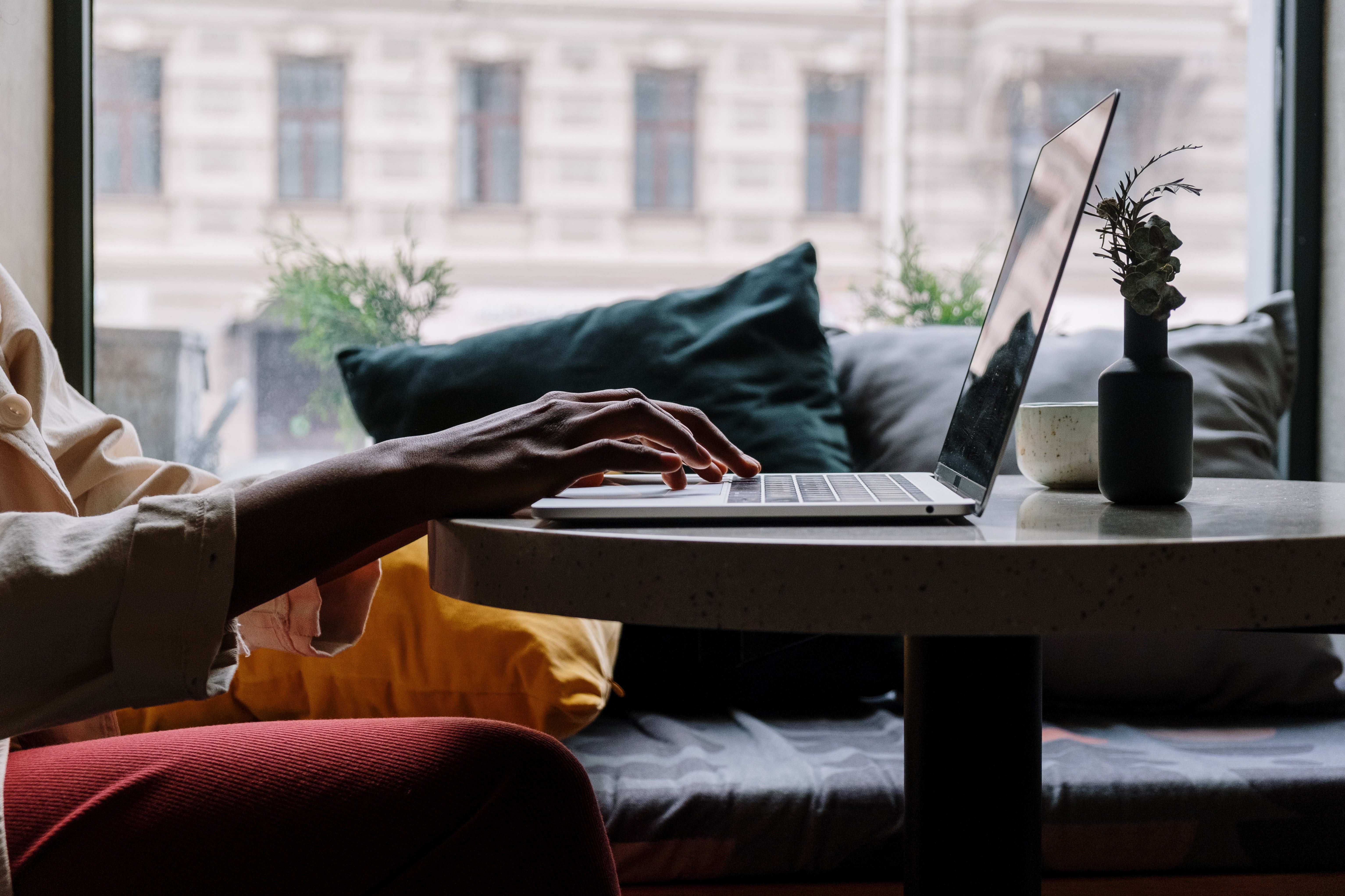Person sitting at desk using a laptop